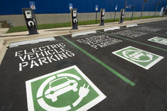 EV Charging Station. Towers and signs in a parking lot Stock Images