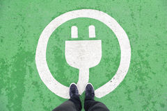 Ev parking station with pedestrian Royalty Free Stock Photo