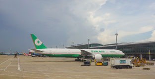 EVA Air airplane docking at the airport in Saigon, Vietnam.  Stock Photography