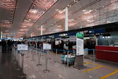Eva Air check-in counter at Beijing airport in China. Beijng, China - October 2017: Eva Air check-in counter at Beijing airport in China. Eva Air is a Taiwanese Royalty Free Stock Images