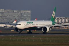Eva Air plane taxiing in Amsterdam Airport Schiphol AMS, Netherlands. Eva Air airplane doing taxi in AMS Airport royalty free stock images