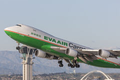 EVA Airways EVA Air Cargo Boeing 747 cargo aircraft taking off from Los Angeles International Airport. royalty free stock photos