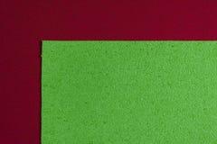 Eva-Schaum apfelgrün auf Rot Stockbilder