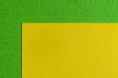 Eva-Schaum zitronengelb auf apfelgrünem Stockbild