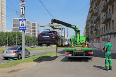 The evacuation of the car. MOSCOW, RUSSIA - JUL 16, 2016: Evacuation of incorrectly parked the car service of the Moscow Parking Stock Image