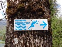 Evacuation - Emergency exit sign stock photos