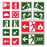 Evacuation and emergency signs in green and red colors. Set. Fire exit, directional arrows and distinguisher symbols in squares isolated vector illustrations Royalty Free Stock Photo