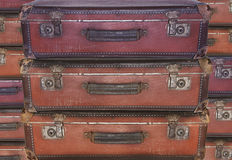 Evacuation - migration - old worn travel suitcases Stock Images