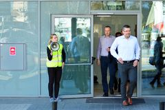 Free Evacuation Of An Office Building. People Exit The Building On Exit Door. Stock Images - 142307734