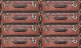 Evacuation - Old worn travel suitcases Stock Photography