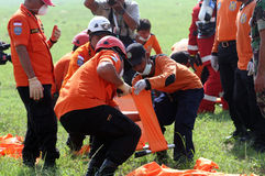Evacuation. Rescuer was practicing evacuation at a field in Boyolali, Central Java, Indonesia Royalty Free Stock Image