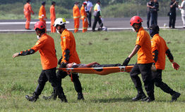 Evacuation. Rescuer was practicing evacuation at a field in Boyolali, Central Java, Indonesia Stock Photo