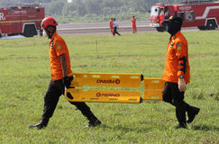 Evacuation. Rescuer was practicing evacuation at a field in Boyolali, Central Java, Indonesia Stock Images