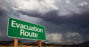 Evacuation Route Green Road Sign and Stormy Clouds. Evacuation Route Green Road Sign with Dramatic Clouds and Rain stock photos