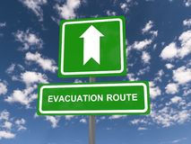 Evacuation route. A traffic sign with the direction to an evacuation route Stock Photo