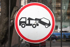 Evacuation on tow truck. Round road sign Royalty Free Stock Images