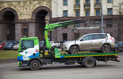 Evacuation vehicles carries evacuated car. Moscow, Russia - March 22 2014: Evacuation vehicles carries evacuated car on the street of the city Stock Photography