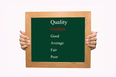 Evaluate excellent quality. Writing evaluate excellent quality concept Stock Images