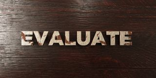 Evaluate - grungy wooden headline on Maple  - 3D rendered royalty free stock image. This image can be used for an online website banner ad or a print postcard Stock Photos