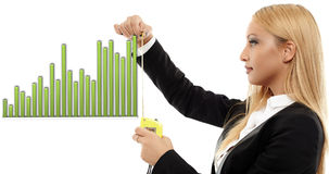 Evaluating success. Young busineswoman evaluating a chart with a measuring tape, concept image of success Stock Photo