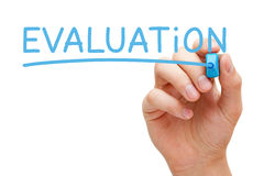 Evaluation Blue Marker. Hand writing Evaluation with blue marker on transparent wipe board royalty free stock photos