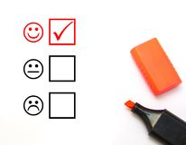 Evaluation. Check mark with red marker on customer service evaluation form stock photos