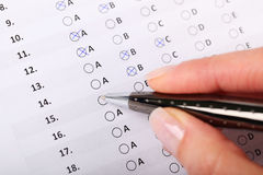 Evaluation form. Business Concept - Hand filling in an evaluation form Stock Images