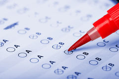 Evaluation form. Business Concept - Hand filling in an evaluation form Royalty Free Stock Images
