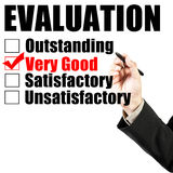 Evaluation form and hand check very good Stock Photography