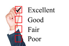 Evaluation form. Tick excellent by businessman Royalty Free Stock Images