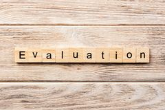 Evaluation word written on wood block. evaluation text on table, concept.  stock image