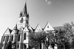 Evangelical Cathedral Sibiu. SIBIU - SEPTEMBER 09: Black and white view of the Evangelical Cathedral in the center of Sibiu, city designated the European Capital Royalty Free Stock Photography