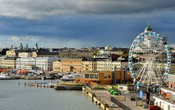 Evangelical Lutheran cathedral of Diocese of Helsinki, Market Square Kauppatori, Allas Sea Pool and Finnair SkyWheel in Septembe. R. Suomi stock photography