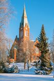 Lutheran Church. The Evangelical Lutheran Church of red brick on the background of blue sky in the Finnish town of Forssa Royalty Free Stock Photography