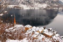 Evangelical steeple and Hallstatt village along the Hallstaetter lake in Austria Stock Images