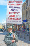 Evangelist in High Street, Inverness. Evangelist in High Street Inverness preaching the Gospel of Jesus Christ and calling for sinners to repent and be baptized Royalty Free Stock Photo