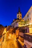 Evanghelical Church in Sibiu. Evanghelical Church's famous tower, landmark of Sibiu, with a medieval street and some of the old town fortification walls Stock Images