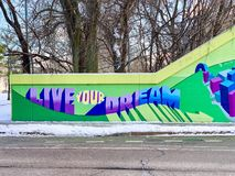 Evanston, IL/USA - 01-13-2019: Colorful mural painted on cement wall with inspiring message stock photo
