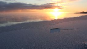Evaporation during the freezing of water in the river, formation of ice, sunset, Ob reservoir, Siberia, Russia. Evaporation during the freezing of water in the stock footage