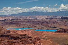 Evaporation Ponds at Dead Horse Point. Potash evaporation ponds. Dead Horse Point State Park near Moab Utah views of canyon and La Sal Mountains. Camping and stock photo