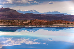 Evaporation Ponds near Potash Road in Moab Utah. Evaporation Pools with La Sale Mountains in the Back against beautiful blue sky royalty free stock photography