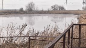 Evaporation of the wastewater on the lake. Evaporation of waste waters on a lake in winter stock video