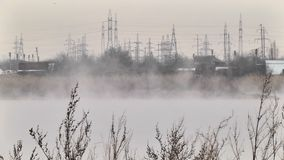 Evaporation of the wastewater on the lake. Evaporation of waste waters on a lake in winter stock footage