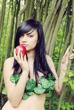 Eve with an apple. Beautiful woman with an apple in the image of Eve Stock Photo