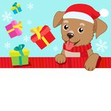 On The Eve. Cartoon Dog With Santa Hat, Gift And Space For Your Christmas Text Vector Banner. Stock Photo