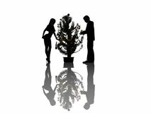 Eve of Christmas at office. Silhouettes of the people еа Christmas Royalty Free Illustration