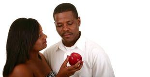 Eve, der Apple Adam anbietet Stockbild