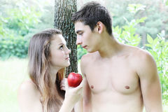 Eve holding an apple. Adam and Eve with a red apple Royalty Free Stock Image