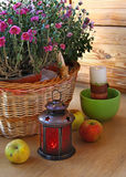 Eve of holiday. chrysanthemums, apples and lantern Stock Photos