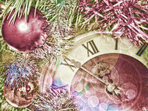 Eve of new year.Clock face and christmas balls. Toned image Stock Photography